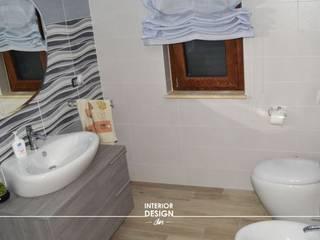Guest bathroom villa Modern bathroom by Sergio Nisticò Modern