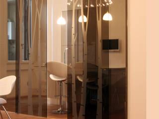 Modern dining room by T+T ARCHITETTURA Modern