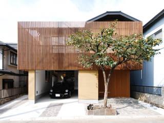 Casas de estilo asiático de 藤井伸介建築設計室 Asiático