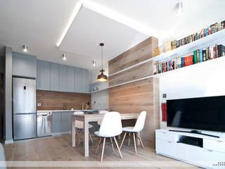 Mieszkanie Twardowskiego: styl , w kategorii Jadalnia zaprojektowany przez PRACOWNIA PROJEKTOWA JAGANNA