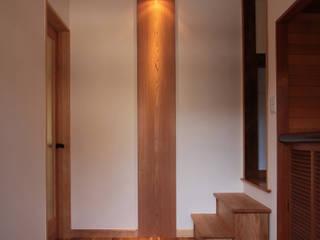 全面リモデル住宅: 有限会社 起廣プランが手掛けた廊下 & 玄関です。
