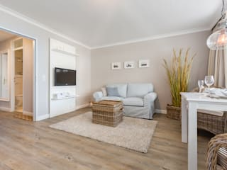 Salas de estar  por Home Staging Sylt GmbH, Moderno