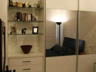 Quarto aconchegante e atemporal.: Quartos  por Eunice Oliveira Arquitetura e Interiores