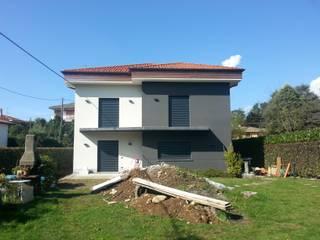 Ristrutturazione e ampliamento: Terrazza in stile  di Andrea Magnoni Architetto, Minimalista