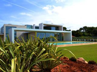 Moradia Frente Mar: Casas  por ARQ TAILOR`S,Moderno
