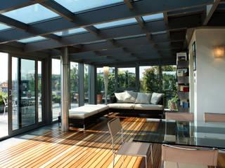 Jardines de invierno de estilo  por T+T ARCHITETTURA, Moderno