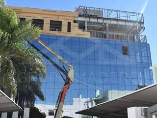 #EDIFICIOSUSTENTABLE   Sede Cooperación Seguros   Venado Tuerto. Edificios de oficinas de estilo moderno de Grupo Madero Moderno