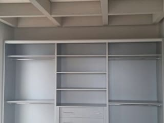 sliding wardrobe: modern Bedroom by Bravo London Ltd