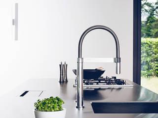 Multifunktionsküche eines Einfamilienhauses:  Küche von hysenbergh GmbH | Raumkonzepte Duesseldorf,Modern