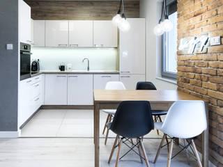 Kawalerka: styl , w kategorii Kuchnia zaprojektowany przez Partner Design