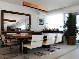 Dining room by daniela kuhn arquitetura