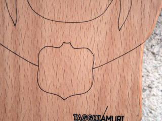 """Tagliere """"Tagghiamuri"""" design siciliano:  in stile  di Ferrantelli Falegnameria Artigiani del Legno"""