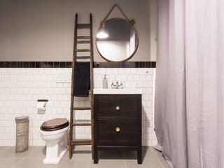 Baños de estilo  por NOMADE ARCHITETTURA E INTERIOR DESIGN
