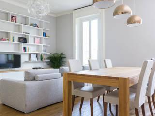 VIALE ABRUZZI: Sala da pranzo in stile in stile Classico di NOMADE ARCHITETTURA E INTERIOR DESIGN