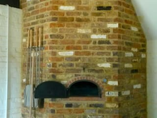Kitchen by wood-fired oven