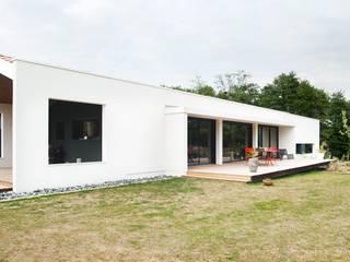 Maison Individuelle à Canéjan: Maisons de style de style Moderne par Plus Architectes