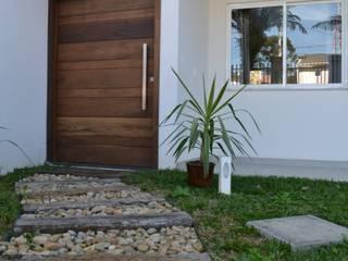 Flávia Kloss Arquitetura de Interiores Modern houses Concrete White