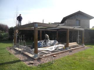 Construcción espacio : Jardines de estilo clásico por Hornero Arquitectura y Diseño