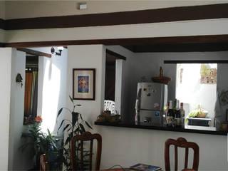 CASA EN EL CARAJO / Reciclaje Arquitectonico ION arquitectura SAS Casas de estilo minimalista