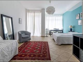 Büro mit Schlafmöglichkeit im Herzen vom Prenzlauer Berg: moderne Schlafzimmer von Smart Travel - Furnished Apartments in Berlin