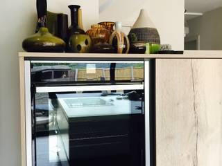 Open plan kitchen in graphite and oak Minimalist kitchen by Four Space Designs Minimalist