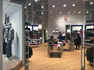 retail Outlet: Negozi & Locali commerciali in stile  di Studio Ad.G.G., Classico