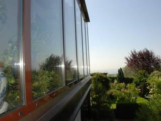Wintergarten in Aluminium und Glas - Farbe dunkelbraun Schmidinger Wintergärten, Fenster & Verglasungen Moderner Wintergarten Aluminium/Zink Braun