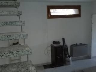 Ristrutturazione chiavi in mano di villetta su due livelli in centro storico 1) Cucina sala da pranzo di Cioci Ristrutturazioni S.r.l.
