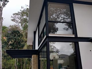 Maisons de style  par Carlos Parada & Associados, Moderne