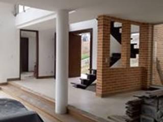 CASA 86 A PARCELACION SAN LUIS:  de estilo  por TORO VARGAS Asesoria & Construccion s.a.s, Moderno