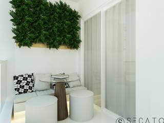 Apto de 65m² Secato Arquitetura e Interiores Varanda, alpendre e terraçoMobiliário