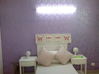 wall paint:  Bedroom by RAWAT PAINTERS