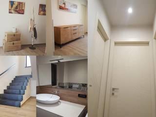 Stile Country Minimal: Ingresso & Corridoio in stile  di ENRICO MARCHIARO _ eMsign Studio _ Architettura_Interior Design