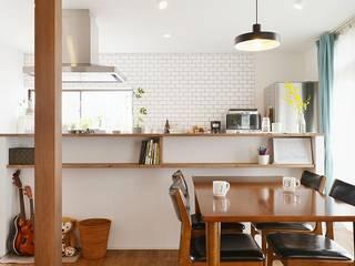 子どもと料理を楽しむアイランドキッチン: 株式会社スタイル工房が手掛けたです。