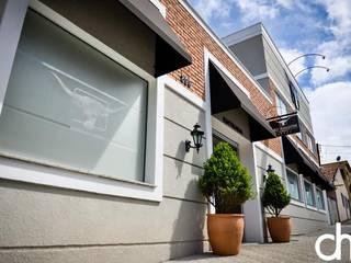 Projeto comercial:   por dm arquitetura e interiores - Dayane e Marina Chemin,