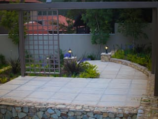 Rogers - Pool area: country Garden by The Friendly Plant (Pty) Ltd