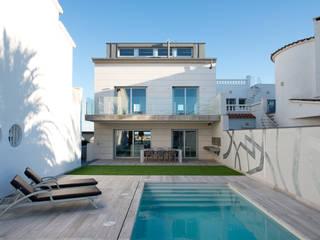Proyecto integral de vivienda en el mar Casas de estilo minimalista de HD Arquitectura d'interiors Minimalista