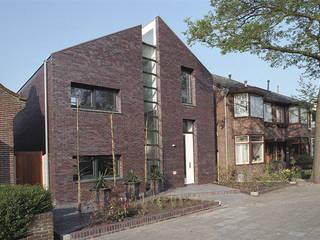 straatgevel:  Huizen door Studio Blanca