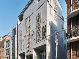 Casas de estilo  de 건축사사무소 어코드 URCODE ARCHITECTURE,