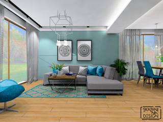 STREFA DZIENNA DOMU W CHUDOWIE, MUŚNIĘTA TURKUSEM Nowoczesny salon od SKAZANI NA DESIGN Studio Architektury Nowoczesny