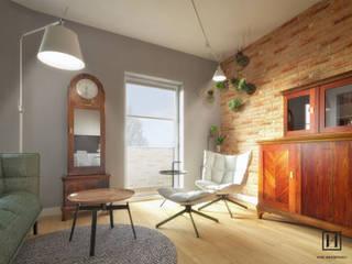 现代客厅設計點子、靈感 & 圖片 根據 Huk Architekci 現代風