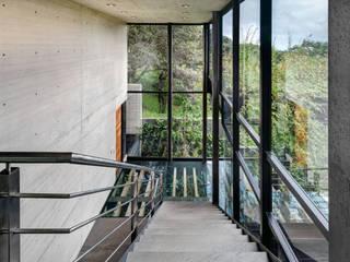 Modern corridor, hallway & stairs by grupoarquitectura Modern