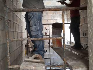 Aplanado de plafón y muros.: Paredes de estilo  por Kaizen Construcción