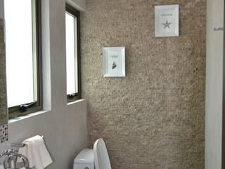 Detalle de baño Baños de estilo moderno de ANTARA DISEÑO Y CONSTRUCCIÓN SA DE CV Moderno Piedra