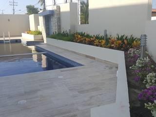 CONJUNTO ANCARES CAMPESTRE - BARRANQUILLA - COLOMBIA BRASSICA SOLUCIONES PAISAJISTICAS S.A.S. Jardines de estilo tropical