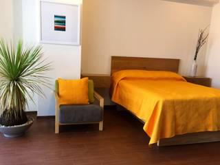 Dormitorios eclécticos de Clorofilia Ecléctico