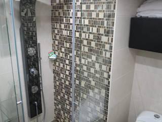 Remodelacion Apto Tibana: Baños de estilo moderno por Remodelaciones y Construcciones Meraki