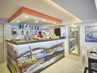 Iluminação LED Lux Concept -  Hostel CIDADE DE AVEIRO: Hotéis  por Lux Concept - Iluminação LED