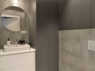Mieszkanie na Bielanach: styl , w kategorii Łazienka zaprojektowany przez Archilens Fotografia wnętrz i architektury