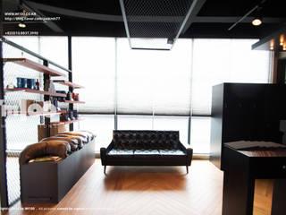 Espacios comerciales de estilo  por im100 communications, Moderno